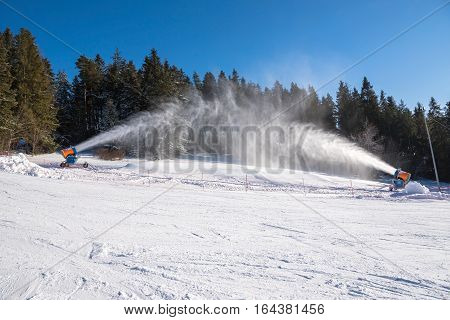 Working snow cannons on a ski slope