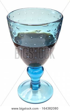 Chrystal glass with rum isolated on white.