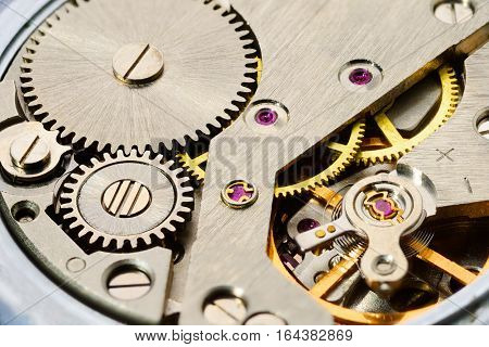 Macro shot of clockwork gears inside the watch