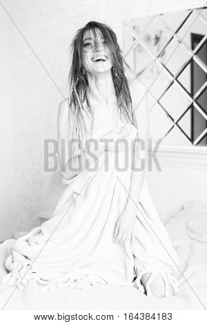 Monochrome Portrait Of Sexy Woman In Bedroom. Sensual Girl Sitting In Bed Covered With Blanket. Blac