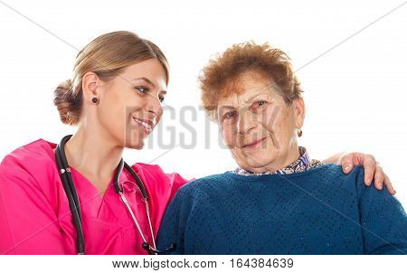 Picture of an elderly woman with her assistant