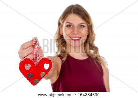 Picture of a beautiful young woman holding a little heart in her hand