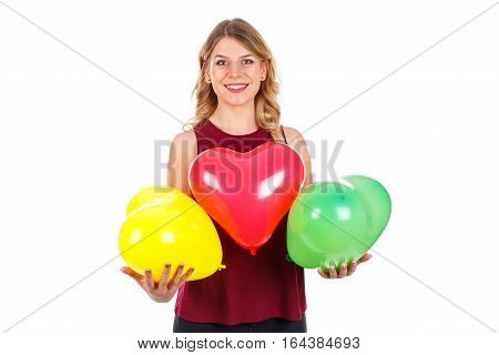 Portrait of a beautiful young girl holding some colorful balloons - isolated background