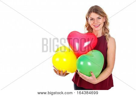 Picture of a beautiful young woman holding some colorful balloons - isolated background