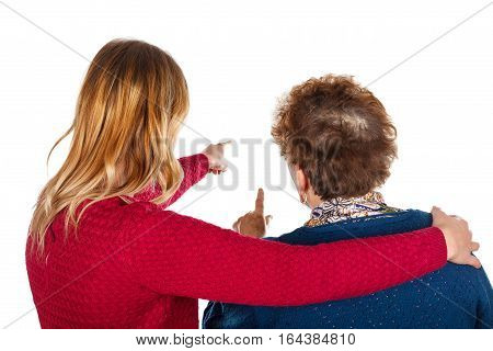 Picture of two ladies pointing something - isolated background