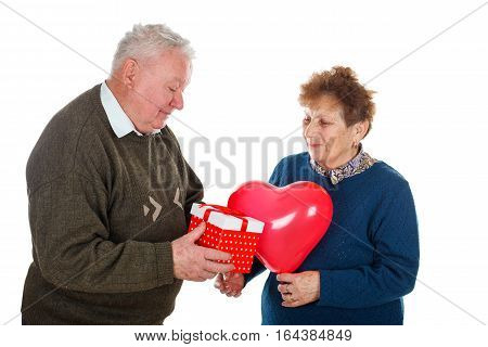 Picture of an old couple celebrating anniversary - isolated background