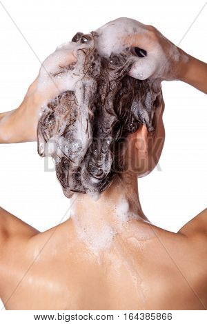 Beautiful woman taking a shower and shampooing her hair. washing hair with Shampoo. studio shot isolated on white background.
