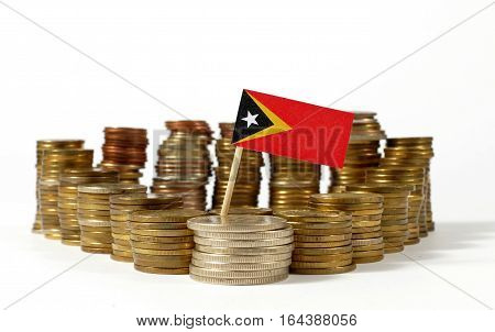 East Timor Flag Waving With Stack Of Money Coins