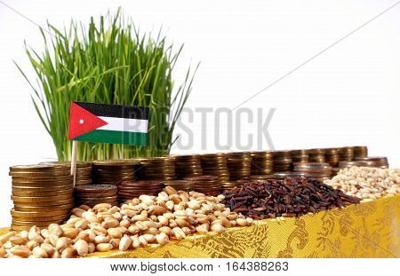 Jordan Flag Waving With Stack Of Money Coins And Piles Of Wheat And Rice Seeds
