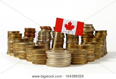Canada Flag Waving With Stack Of Money Coins