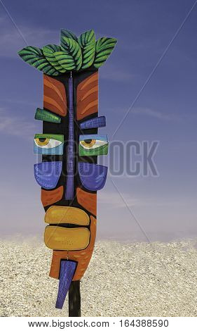 ST. PETE BEACH, USA - FEBRUARY 8, 2016: A wood cutout of an African tribal face on outdoor display in St. Pete Beach, Florida. This is a larger scale of the tribal mask used for ritual ceremonies.