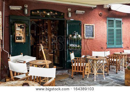 PORTOFINO, ITALY - DECEMBER 11, 2016: Exterior of Italian cafe at coast of Portofino town, Liguria, Italy