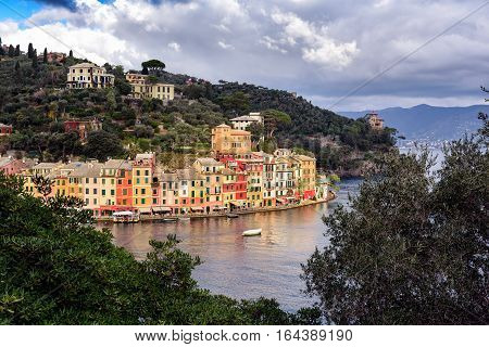 Aerial view on lagoon near Portofino town in Liguria, Italy. A vacation resort with a picturesque harbor and with celebrity and artistic visitors.
