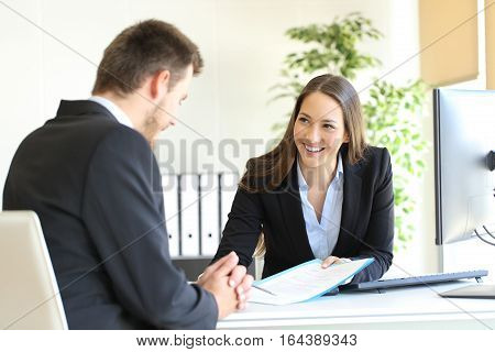Dealer attending to a customer in a desktop in the office