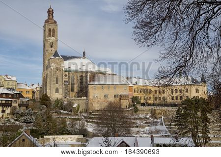 St. James church and Italian court in town Kutna Hora Czech republic snow