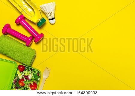 Healthy lifestyle food sport or athlete's equipment on bright background. Flat lay. Top view with copy space.
