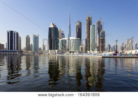 DUBAI UAE - NOV 27 2016: The Dubai Business Bay skyline. United Arab Emirates Middle East