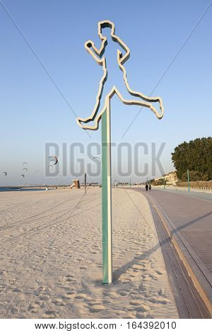 DUBAI UAE - NOV 27 2016: Jogging and walking line at the Jumeirah open beach in Dubai. United Arab Emirates Middle East