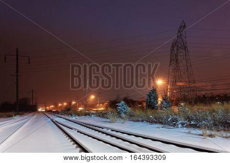 Winter night road snow covered Railroad terrain road train railway road