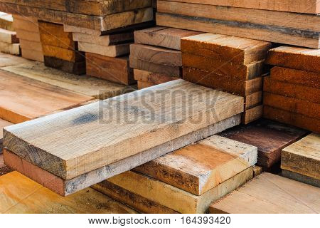 Wood panels that stand out from the pile of wood.