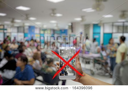 No photography allowed in hospitals, smartphone no camera hospital, blurred background