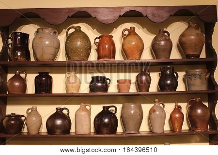 wooden shelves with primitive homemade clay jugs