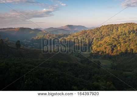 Scenery of morning view in Nan province on rural road No.1026 with mountain view and mist covered in morning.