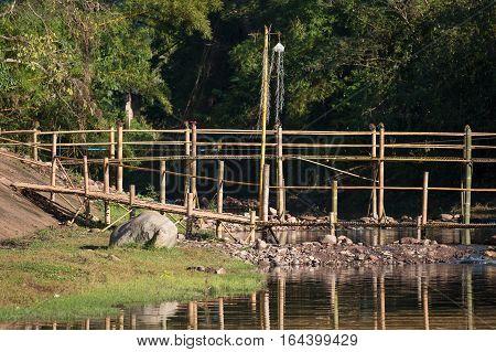 Wooden bridge in countryside village in Pua, Nan province,Thailand.