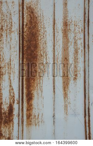 Rusted Metal Siding Vertical Close Up in Industrial District