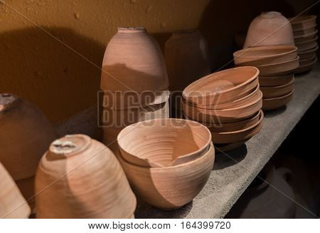 Pots And Pottery On Shelf Displayed At Qumran Site. Israel