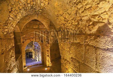 ALJUN, JORDAN - NOVEMBER 24, 2016 Qalat ar-Rabid Ancient Arabic Fortress Castle Stone Corridor Ajlun Jordan. Ancient Arabic Castle built in 1184-1185 to counter Crusader threat.