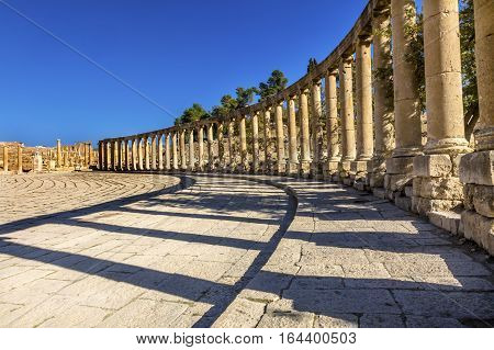 Oval Plaza 160 Ionic Columns Ancient Roman City Jerash Jordan. Jerash came to power 300 BC to 100 AD and was a city through 600 AD. Not conquered until 1112 AD by Crusaders. Famous Trading Center. Most original Roman City in the Middle East.