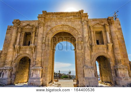 Hadrian's Arch Gate Sun Ancient Roman City Jerash Jordan. Jerash came to power 300 BC to 100 AD and was a city through 600 AD. Not conquered until 1112 AD by Crusaders. Famous Trading Center. Most original Roman City in the Middle East.