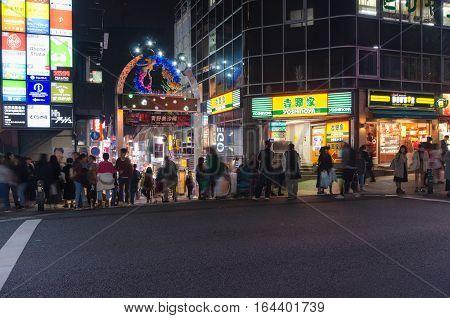 Tokyo Japan - November 20 2016 : Takeshita Street in Harajuku at night Japan.Takeshita Street is the famous fashion shopping street next to Harajuku Station
