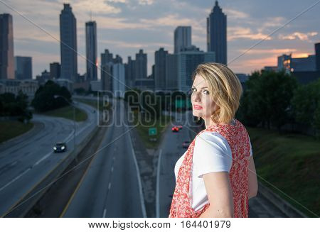 outdoor portrait of beautiful girl on urban background at Freedom Parkway during sunset in Atlanta Georgia