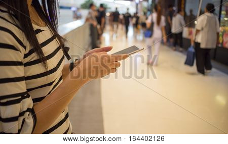 The Social Network Women play smart phones Department store