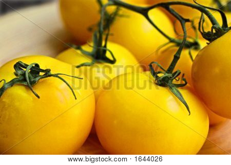 Yellow Tomatoes On Vine On A Bambu Plte