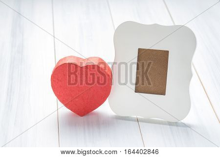 White Vintage Frame With Red Heart Gift Box On White Wood Table Top,valentine Greeting Card,love Con