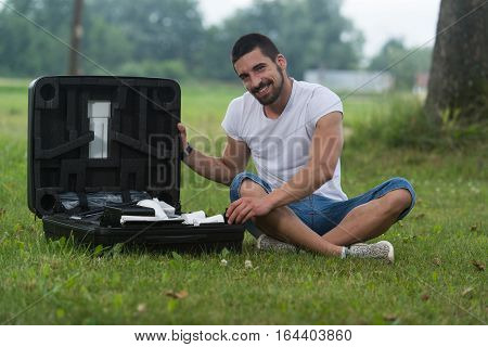 Man Opens The Suitcase From Drone