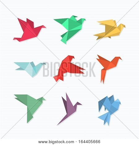 Origami paper birds in a flat style. Vector illustration of pigeons / doves / colibri / hummingbirds set on a light background. Polygonal shape. Paper figures on flight.