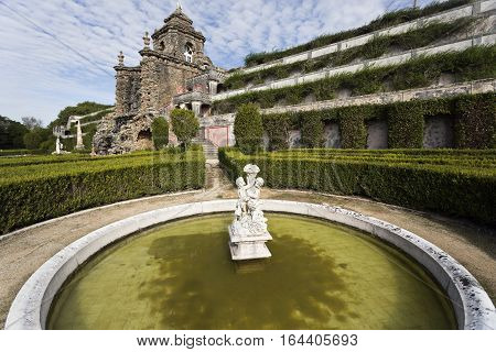CAXIAS, PORTUGAL - October 26, 2016: View of Fountain of Spring one of the four season fountains with the Monumental Cascade and garden terraces in the background at Royal Garden of Caxias Portugal