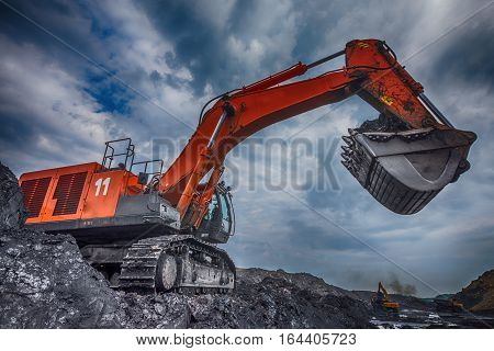 NOVOKUZNETSK, RUSSIA - JULY 26, 2016 Big orange excavator at worksite