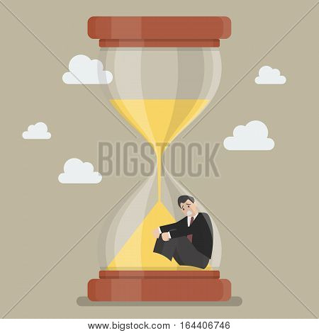 Businessman stuck in sandglass. Business deadline concept
