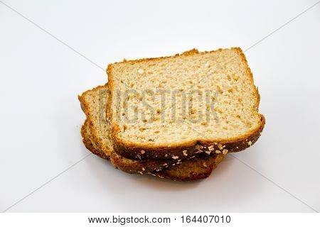 Photograph of some bread slices on white background