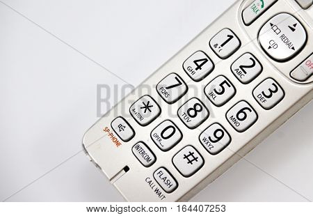 Photograph of a wireless phone detail and white background