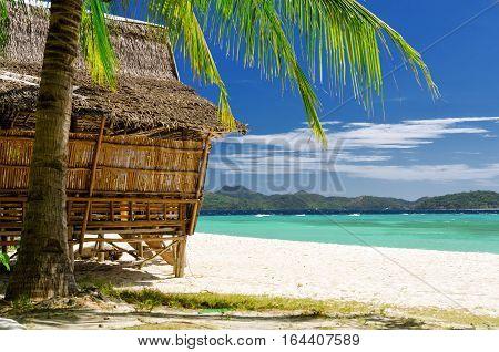 Bamboo Hut On A Tropical Beach