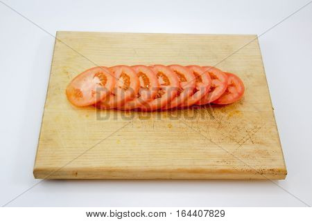 Tomato Slices On Wood Cutting Board