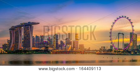 SINGAPORE - JULY 9 2016 : Skyline and view of skyscrapers at sunset time in Singapore.