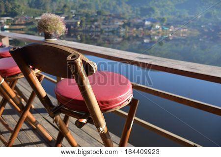 red wood chair and lakeview at thailand