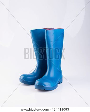 Shoe Or Blue Color Rubber Boots On A Background.